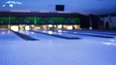 Bowling alley lit up for lunar bowl Stock Footage