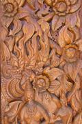 Wood carving decorated at windows of the temple, hand made by thai artisan Stock Photos