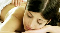 Closeup of young woman getting back massage in spa - stock footage
