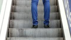 A man going up on escalator stairway Stock Footage