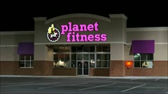 Planet Fitness exercise club - night time loop - stock footage
