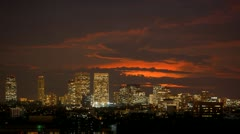Sunset over Century City skyline, Los Angeles. Dusk to night transition. Stock Footage