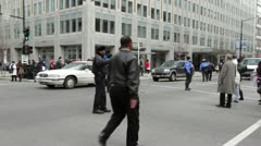Police stopping crowds for traffic to go by Stock Footage