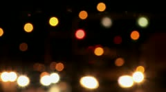 Abstract soft focus city traffic, headlights, traffic lights - stock footage