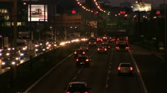 City evening traffic, headlights, taillights, neon signs - stock footage