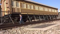 Little boy walking on old rail road Stock Footage