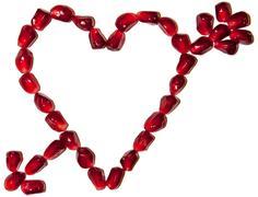 Love symbol made of pomegranate seeds Stock Photos