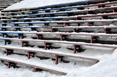Stock Photo of closeup bandy stadium stands under snow