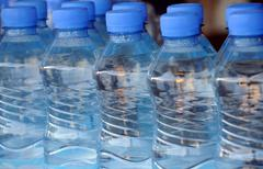 closeup mineral water bottles - stock photo