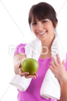 Stock photo of young caucasian woman holding  an apple