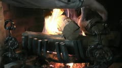 Man Places Logs In Fireplace Stock Footage