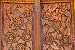 Wood carving decorated at windows of the temple Stock Photos