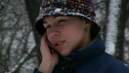 Girl talking on cellular phone Stock Footage
