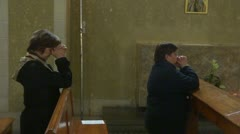 Pray in church Stock Footage