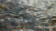 Water ripples with reflections stones on the bottom Stock Footage