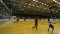 Women playing indoor soccer/football Stock Footage