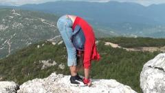 Face to knees asana at highlands Stock Footage