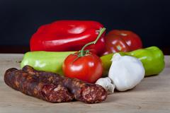 Vegetables  with sausages Stock Photos