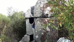 Man exploring tombs 2 Stock Footage