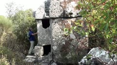 Man exploring tombs Stock Footage