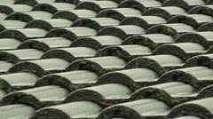 Rain falling on a tiled roof Stock Footage