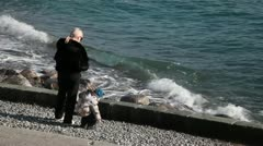The Grandmother And A Baby At The Seashore - stock footage