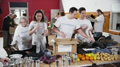 Charity volunteers sorting through donated goods - stock footage