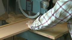 Woodworking: cross cut using a radial arm saw with sound Stock Footage