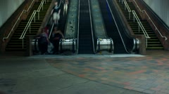 Commuters on escalator - stock footage