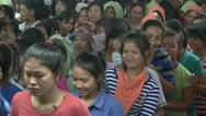 Stock Video Footage of Textile Garment Factory: Crowd of garment workes breaks for lunch