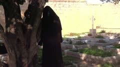 Franciscan nun in church monastery Stock Footage