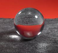 Crystal ball on stone surface Stock Photos
