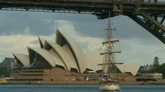 Old fashioned ship sailing towards Sydney Opera House - stock footage