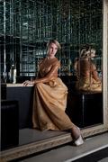 Stock Photo of woman sitting on sofa in club