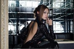 beautiful young woman in nightclub - stock photo