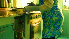 Elder woman preparing lunch in the kitchen Stock Footage