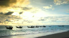 Fishing boats on the beach Stock Footage