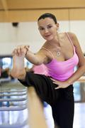 Woman stretching before dancing Stock Photos