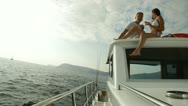 Stock Video Footage of Couple Enjoying Summer Vacation On Weekender Yacht