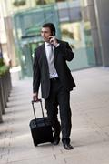 Businessman traveller with suitcase Stock Photos
