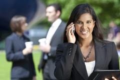 young asian businesswoman on her cell phone - stock photo