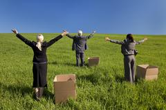business team men and women in green field - stock photo