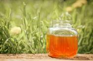 Flowery honey in glass jar Stock Photos