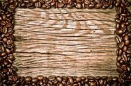 Coffee beans on wood texture Stock Photos