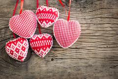 Hearts on wooden background Stock Photos