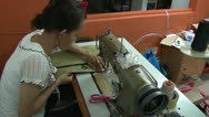 Stock Video Footage of Seamstress operates sewing machine