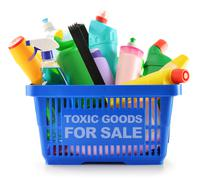 shopping basket with detergent bottles and chemical cleaning supplies - stock photo