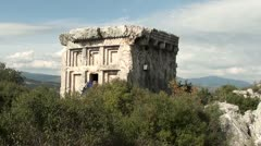 Tourist exploring a tomb of house-type Stock Footage