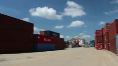 Stock Video Footage of SHIPPING PORT: Pan around shipping containers in port with loader