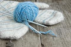 balls of yarn and mittens - stock photo